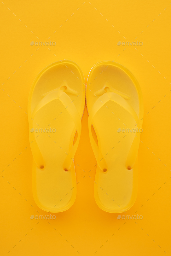 Top view of yellow flip flops pair - Stock Photo - Images