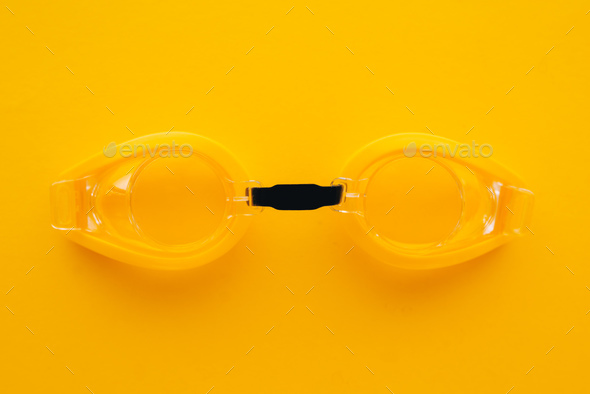 Swimming goggles on yellow background - Stock Photo - Images