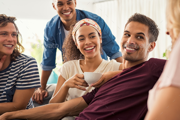 Happy young friends at home - Stock Photo - Images