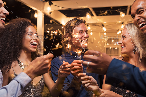 Friends celebrating new year's eve - Stock Photo - Images
