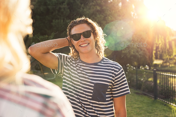 Young man with sunglasses at park - Stock Photo - Images