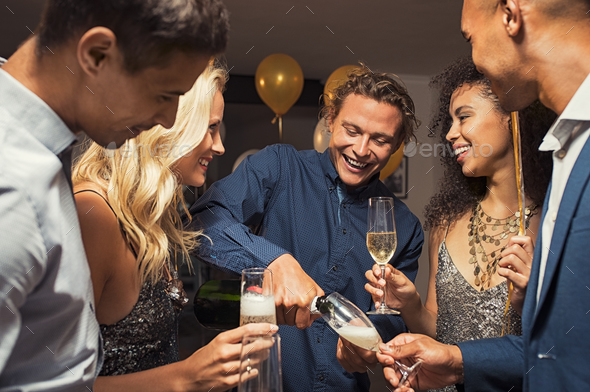 Man pouring champagne in flutes - Stock Photo - Images
