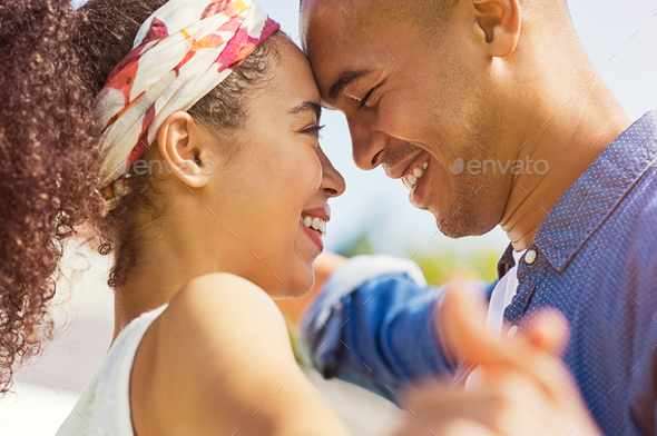 African couple looking at each other - Stock Photo - Images