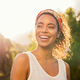 Young african woman smiling at sunset - PhotoDune Item for Sale