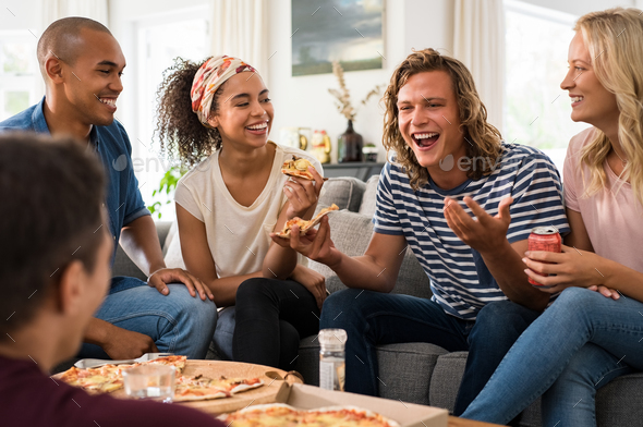 Friends enjoying pizza party - Stock Photo - Images
