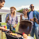 Friends enjoying party with bbq - PhotoDune Item for Sale