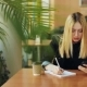 Young Girl with Smartphone Doing Homework Sitting in Cafe - VideoHive Item for Sale