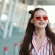 Fashion Model in Red Sunglasses Walks Confident Along the Street Near Shopping Centre. Summer Time - VideoHive Item for Sale