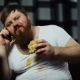 Dirty Fat Bearded Man Talks on the Smartphone, Eating a Burger and Drinking Beer - VideoHive Item for Sale