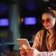 Young Attractive Woman in Red Sunglasses with Tablet Computer Sitting in Cafe. Beautiful Girl in - VideoHive Item for Sale