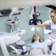 Female Dentist with Dental Tools - Microscope, Mirror and Probe Treating Patient Teeth at Dental - VideoHive Item for Sale