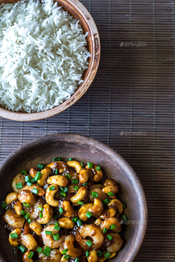 Portion of cashew shrimp stir-fry with rice - Stock Photo - Images