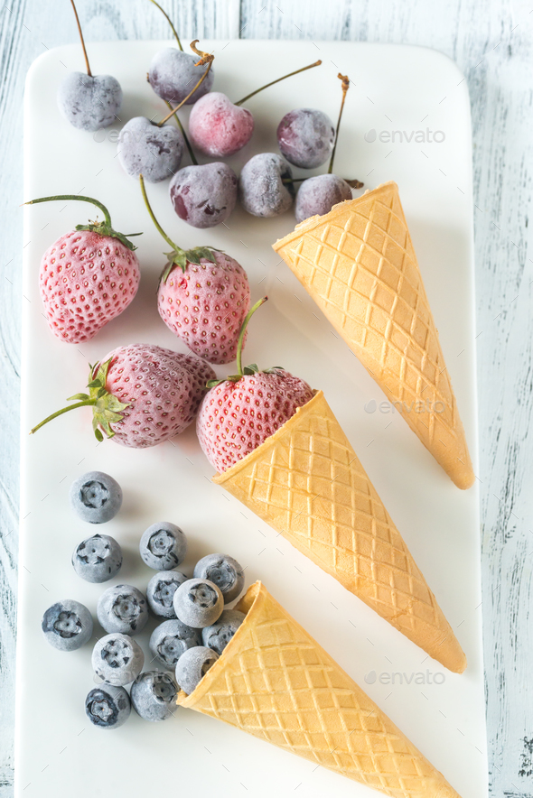 Frozen berries in waffle cones - Stock Photo - Images