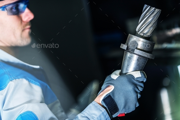 Worker with Machine Part - Stock Photo - Images