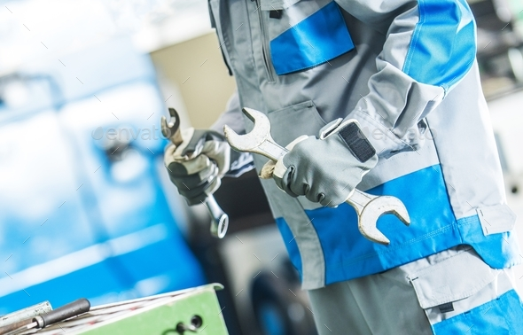 Technician Fixing Machinery - Stock Photo - Images