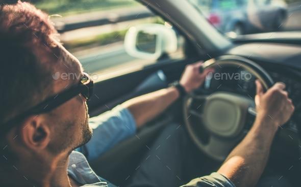 Men Behind the Steering Wheel - Stock Photo - Images