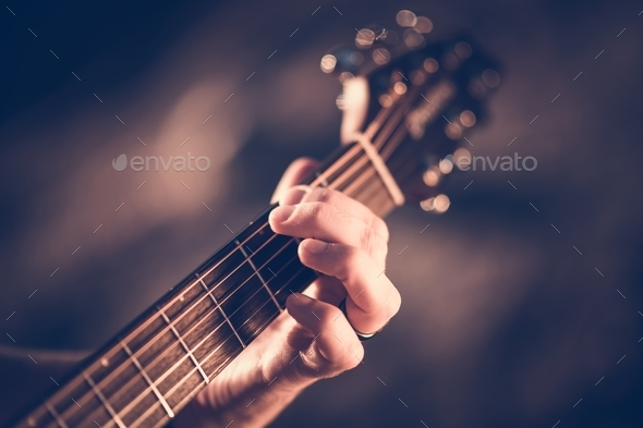 Learning Acoustic Guitar - Stock Photo - Images
