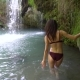 A Beautiful Girl Approaches the Tropical Waterfall - VideoHive Item for Sale