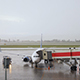 Plane At The Airport In The Rain - VideoHive Item for Sale