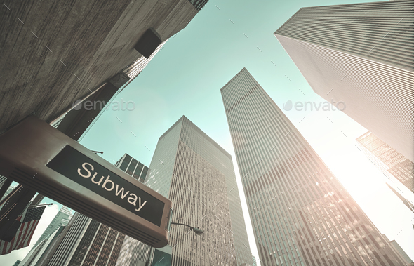 Subway entrance sign and New York skyscrapers. - Stock Photo - Images