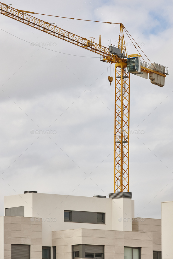 Modern building and crane machinery structure. Construction industry. Vertical - Stock Photo - Images