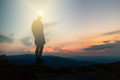 Man celebrating sunset looking at view in mountains - PhotoDune Item for Sale