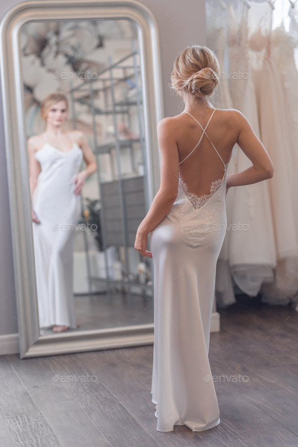 Attractive bride at the mirror - Stock Photo - Images