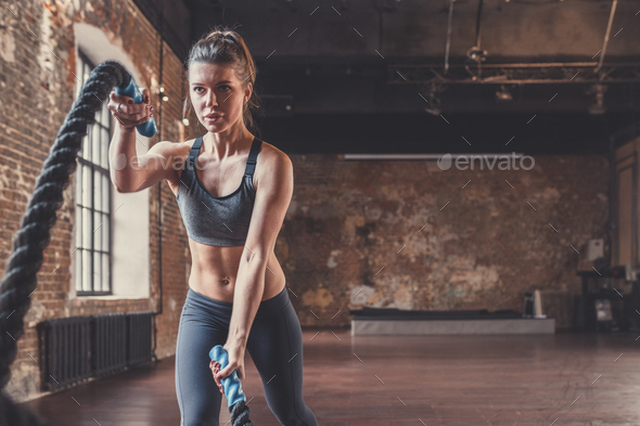Young sporty woman with a rope - Stock Photo - Images