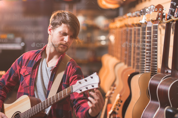 Young musician in the store - Stock Photo - Images