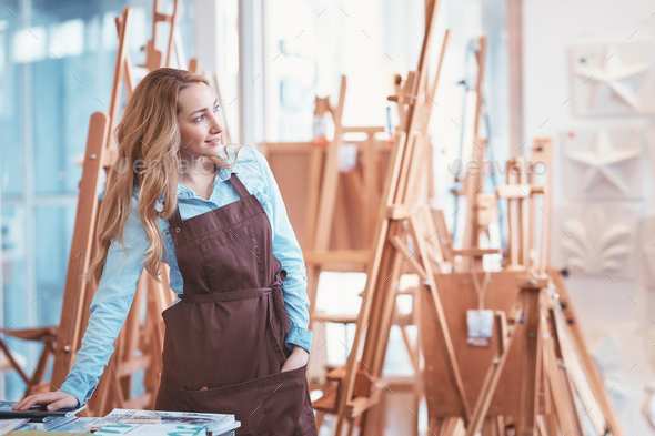 Young artist with easels - Stock Photo - Images