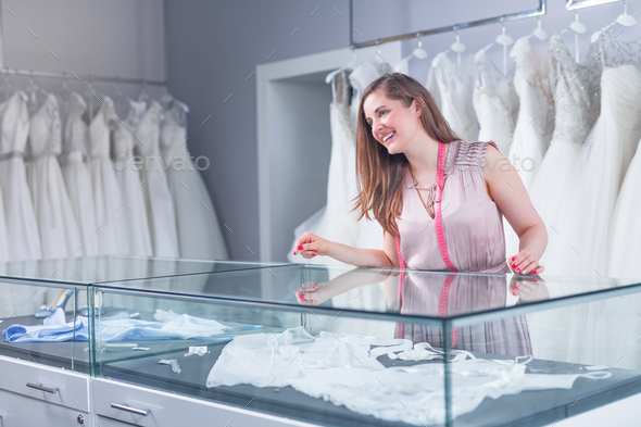 Young seller in a wedding shop - Stock Photo - Images