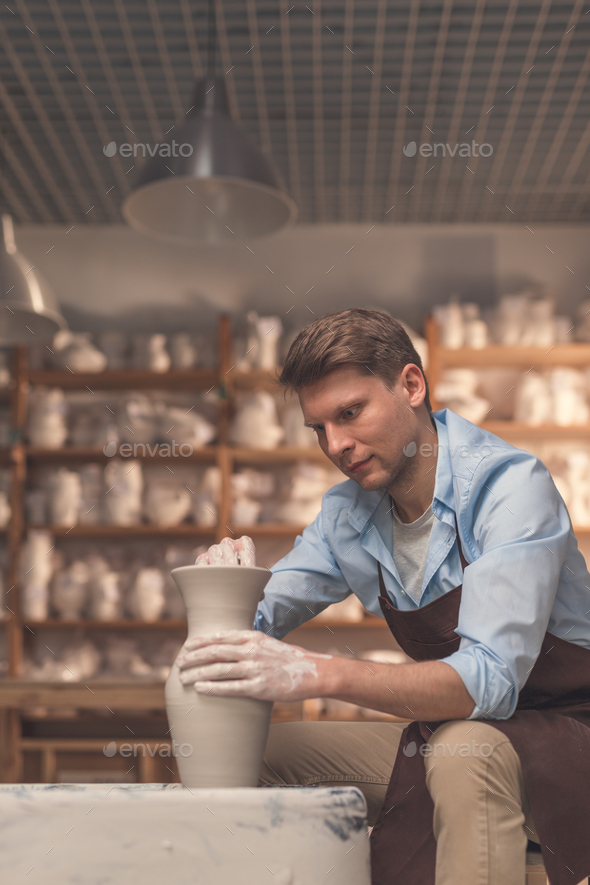 Young man in pottery - Stock Photo - Images