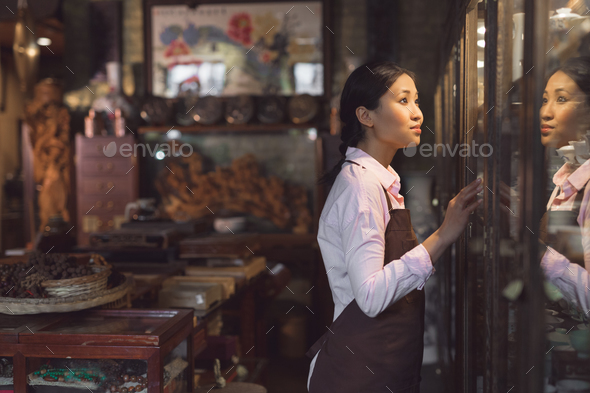 Young woman in an apron - Stock Photo - Images