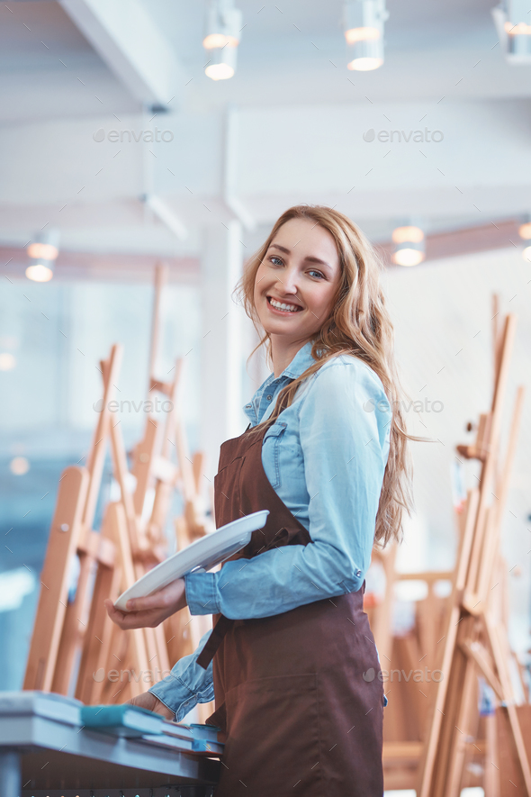 Happy young artist with easels - Stock Photo - Images