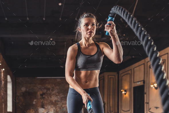 Sporty woman in the loft - Stock Photo - Images
