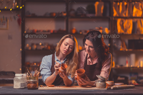 Drawing girls in a pottery - Stock Photo - Images