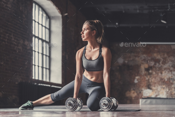 Athletic girl with dumbbells - Stock Photo - Images