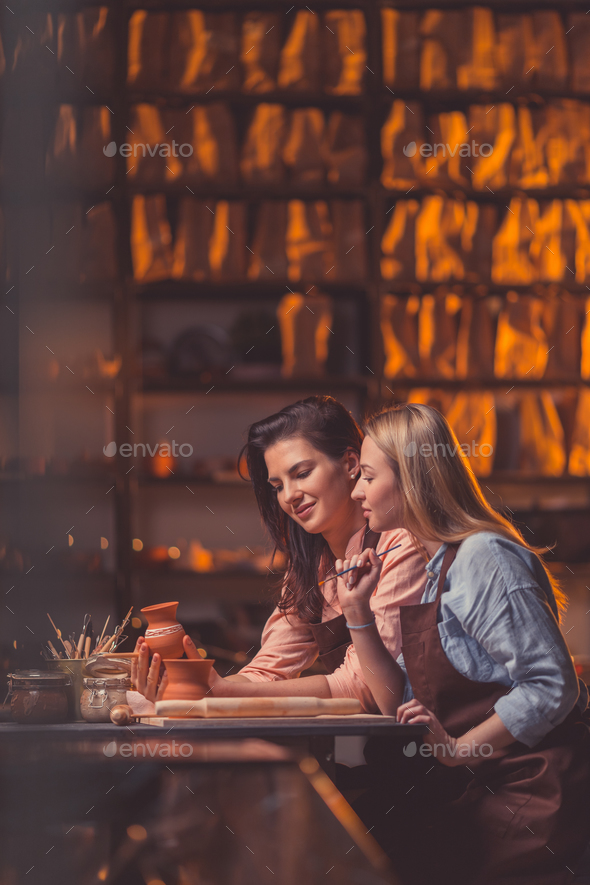 Attractive girls in pottery - Stock Photo - Images