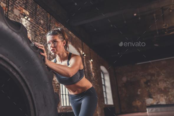 Young sporty woman with a wheel - Stock Photo - Images