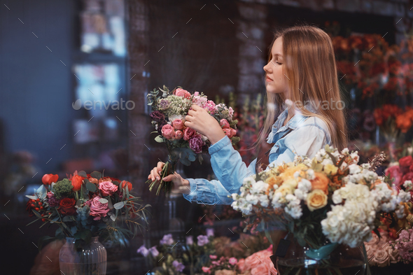 Young florist with flowers - Stock Photo - Images