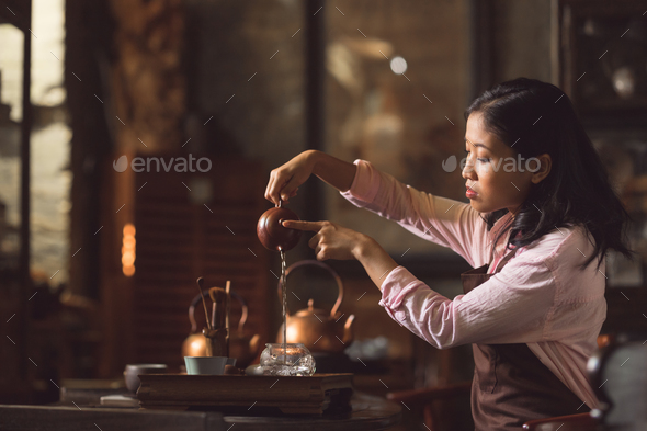 Young girl pouring tea - Stock Photo - Images