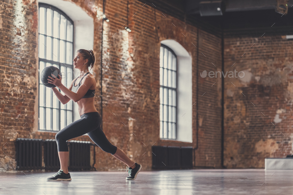 Sporty young girl with a ball indoors - Stock Photo - Images