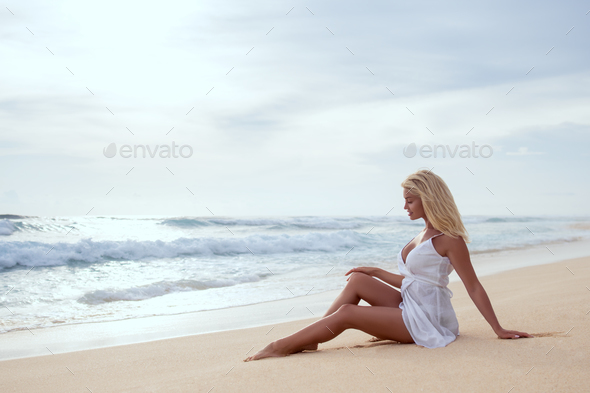 Beautiful young girl on the beach - Stock Photo - Images