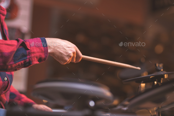 Male hands playing the drums indoors - Stock Photo - Images