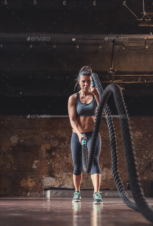 Young sporty woman at workout - Stock Photo - Images