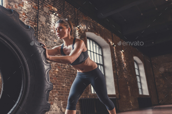 Young athletic woman with a crossfit wheel - Stock Photo - Images