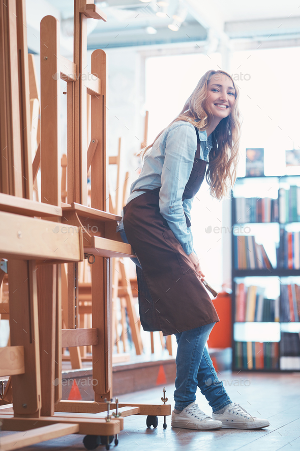 Happy young girl with easels - Stock Photo - Images