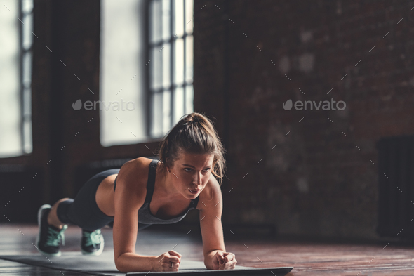 Young girl in cross-training indoors - Stock Photo - Images