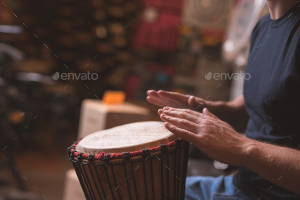 Young man playing drums - Stock Photo - Images