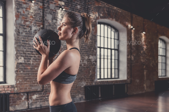 Young attractive woman with a ball - Stock Photo - Images